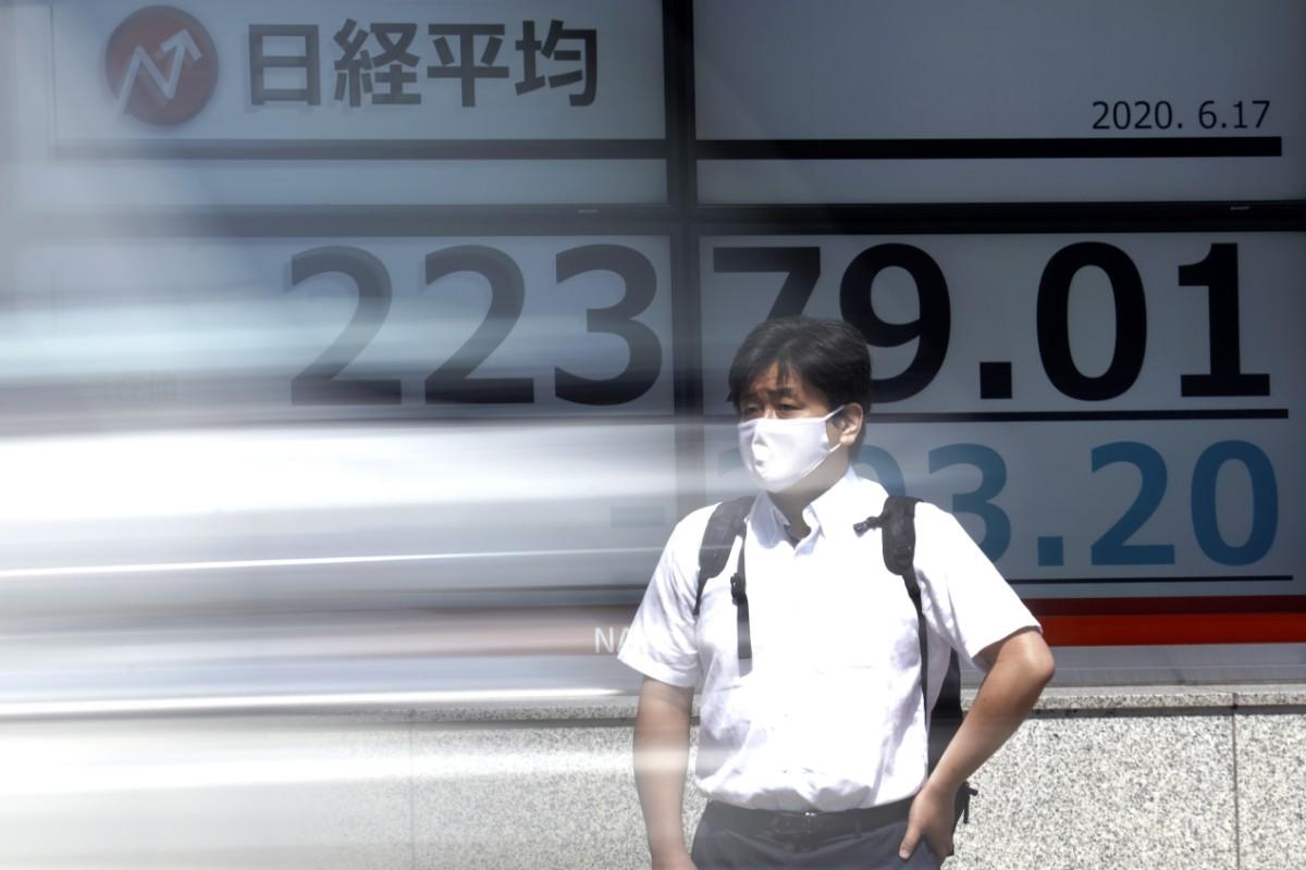 Tokyobörsen följer USA-börser ner