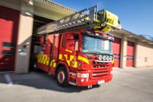 Larm om brand i industri